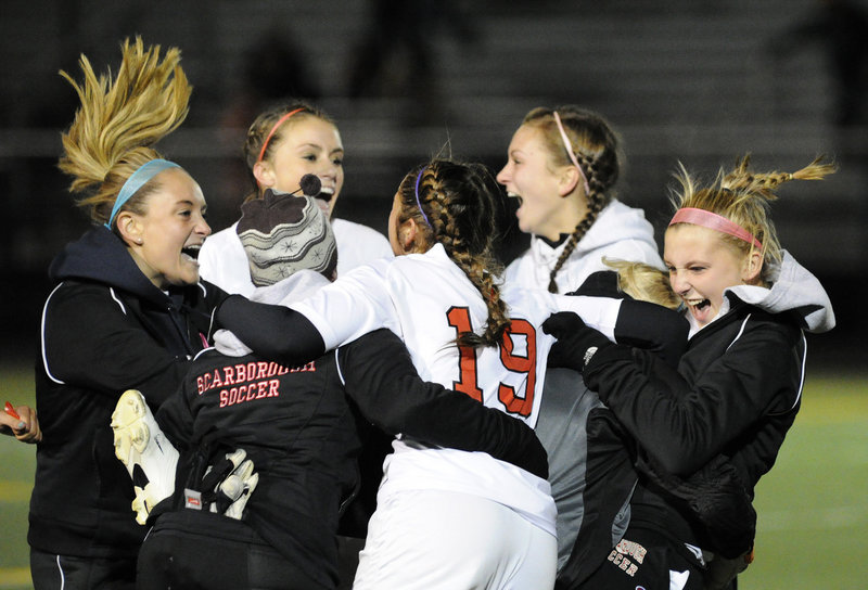 Jessica Broadhurst, 19, of Scarborough celebrates with her teammates Wednesday night after the Red Storm won the Western Class A title with a 1-0 victory against Thornton Academy.