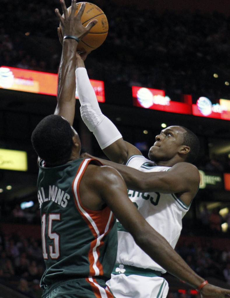 Rajon Rondo of the Boston Celtics drives against John Salmons of the Milwaukee Bucks in the first quarter Wednesday night.
