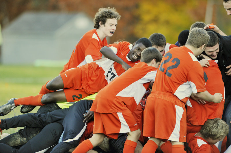 There was plenty to celebrate Wednesday for the North Yarmouth Academy boys' soccer team, which was 3-5 in the second week of October, yet recovered to win the Western Class C championship.