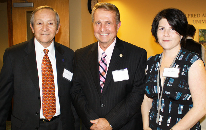 Charles Hoff, David Hughes and Beth Round, who heads USM's Honors Program.