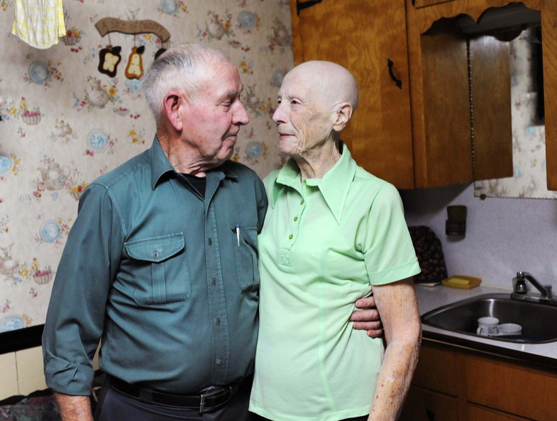 Allen and Violet Large stand arm-in-arm in the kitchen of their Lower Truro, Nova Scotia, home. The couple gave away about $10.6 million in lottery winnings.