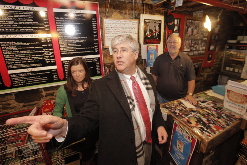Portland Mayor Nick Mavadones orders a from the lighter side menu at Anthony's Italian Kitchen on Thursday. New menus with calorie counts were made with help from Portland s Smart Meals for ME program. At left is Stephanie Agne, the city nutritionist who counted calories. Owner Anthony Barrasso is at right.