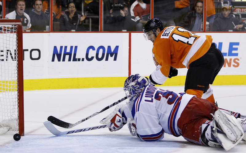 Blair Betts of the Flyers pushes the puck past Rangers goalie Henrik Lundqvist for one of Philadelphia's three second-period goals Thursday night in a 4-1 victory.