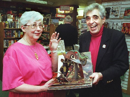 """Carole Lerner and her husband, Paul, are shown in 2000 at the Owl & Turtle Bookstore in Camden. The Lerners are holding """"The Pop-up Book of Phobias"""" by Gary Greenberg."""