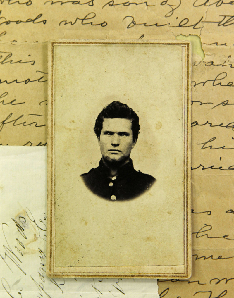 A portrait of Civil War soldier Sgt. Alfred Covell Woods rests on top of his notes at the New York State Library in Albany, N.Y. A granite tombstone for Woods will be unveiled Sunday in a cemetery in his hometown of Crown Point, N.Y.
