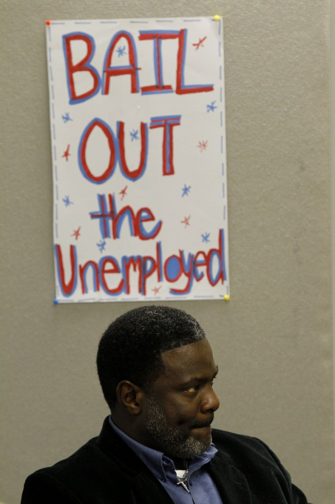Dennis Spain, who has been unemployed for two months, listens to others relate their experiences with joblessness at a Philadelphia Unemployment Project meeting Thursday. Up to 2 million people could lose unemployment benefits if Congress doesn t act.