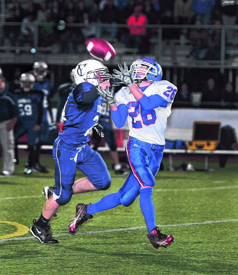 Craig Morrill of Oak Hill gets a step on Anders Overhaug of Yarmouth to haul in a first-quarter pass Friday night. Morrill also caught a 73-yard pass in the third quarter his team s only score as Yarmouth came away with a 28-7 victory at home.