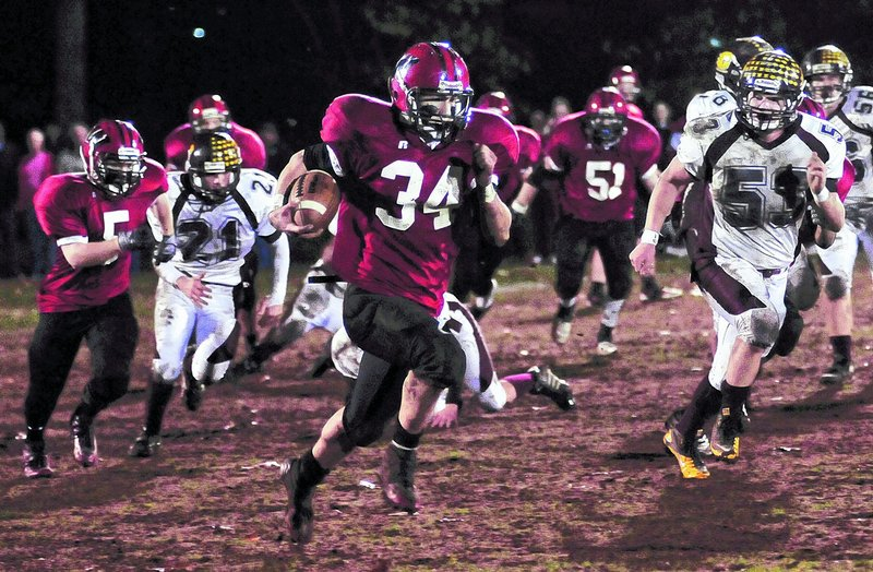 Louis DiTomasso of Wells breaks into the open on his way to a 68-yard touchdown run in the second quarter of a 47-7 victory over Cape Elizabeth in a Western Class B football semifinal Friday night at Wells.