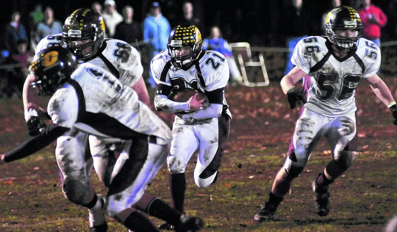 Vin Dell Aquilla of Cape Elizabeth follows his blockers and looks for running room Friday night against Wells in the Western Class B semifinals.