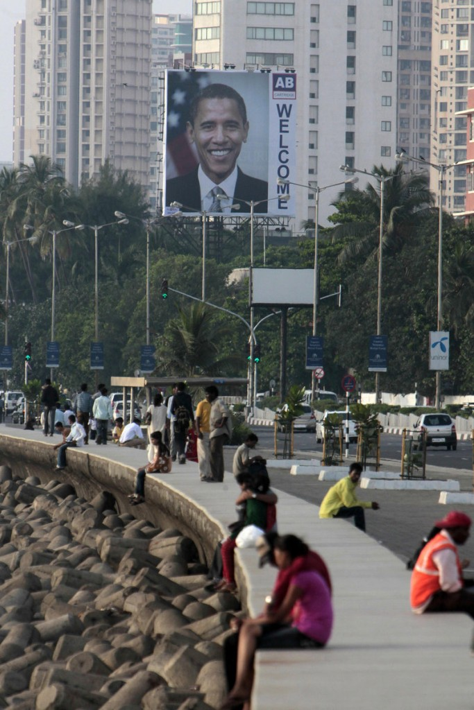 A billboard of President Obama rises above traffic Friday on Marine Drive in Mumbai, India. Obama is scheduled to spend about a day and a half in the city before heading to the capital of New Delhi for meetings with government leaders including the prime minister.