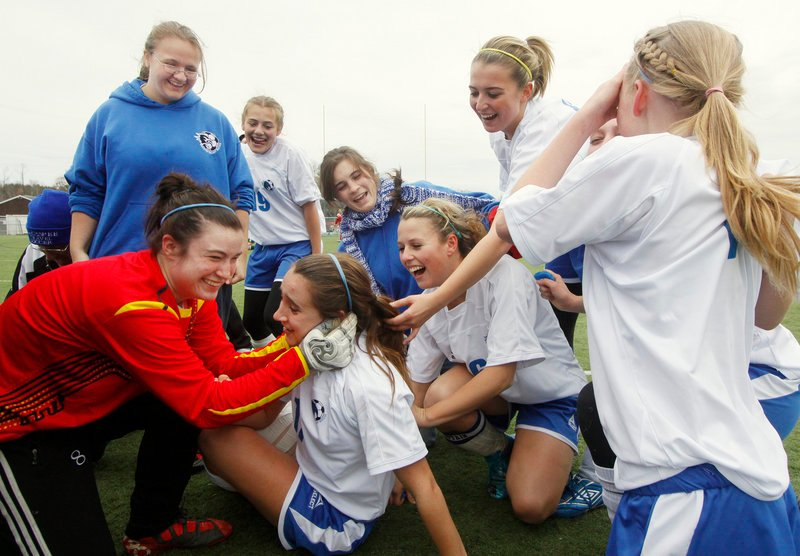 Emily Lane was on the ground and taking congratulations from teammates Saturday after scoring the overtime goal that gave Sacopee Valley its first girls soccer state title