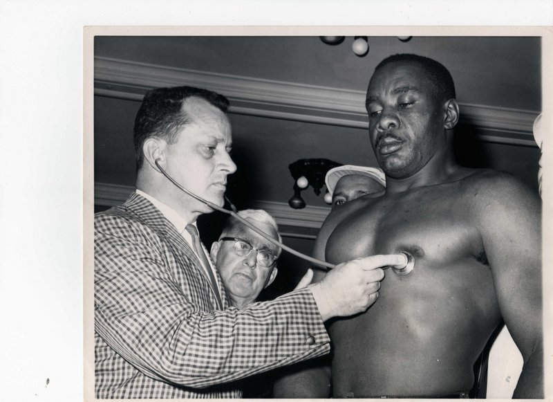 Dr. Raphael Turgeon examines Sonny Liston prior to the infamous 1965 fight with Cassius Clay in Lewiston.