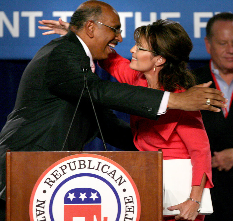 "Former Alaska Gov. Sarah Palin hugs Republican National Committee Chairman Michael Steele during a rally in Orlando, Fla., on Oct. 23. Steele embraces Palin's ability to galvanize voters, calling it ""a very powerful force in politics."""