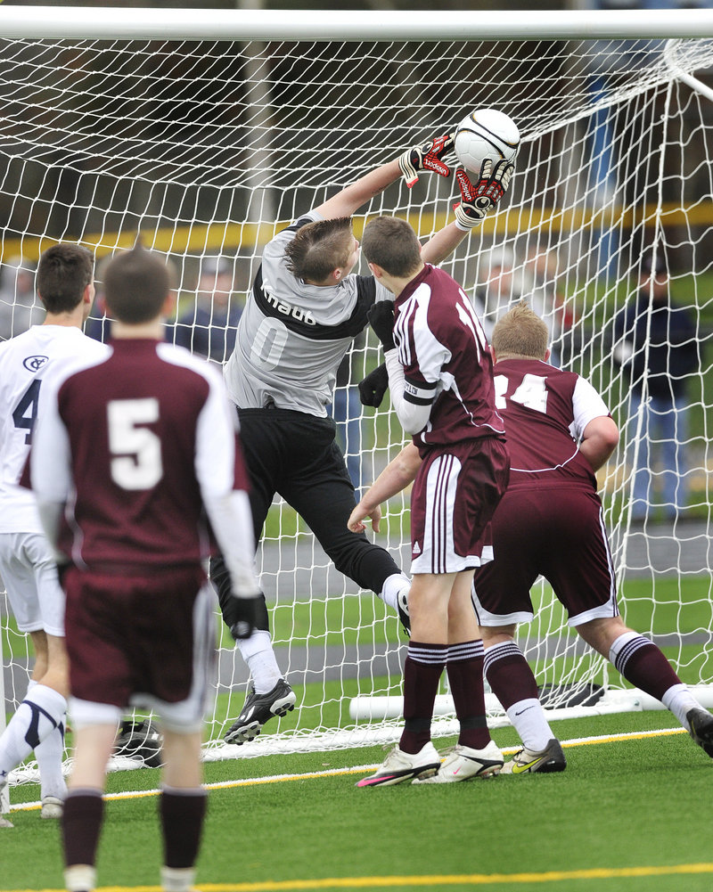 Yarmouth keeper Chris Knaub makes an off-balance save on an Ellsworth shot Saturday to preserve the Clippers shutout of the Eagles. Yarmouth finished the season at 17-0-1.