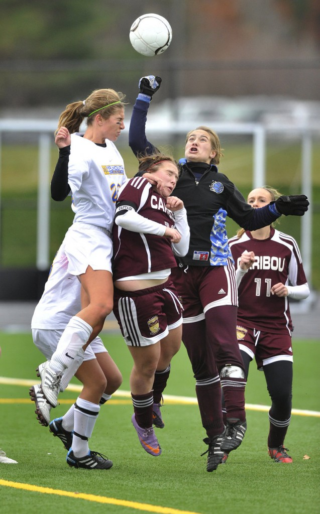 Caribou goalie Morgan Swan punches the ball away as Falmouth applies pressure during its 1-0 victory in the Class B girls' soccer state final.