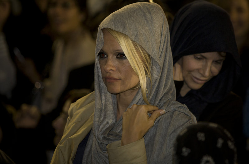 U.S. actress Pamela Anderson visits Jerusalem's Western Wall on Sunday. An honorary PETA director, she praised Israel for having no fur farms.