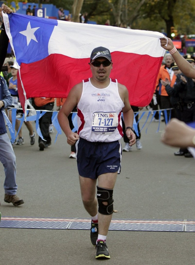 Chilean miner Edison Pena approaches the finish line after running in the New York City marathon on Sunday.