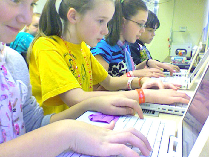 Bonny Eagle Middle School students, from left, Samantha Morash, Calleigh McCullough, Megan Roy and Zach Steinwachs, participate in an online session to solve a math problem during a recent American Math Challenge event.