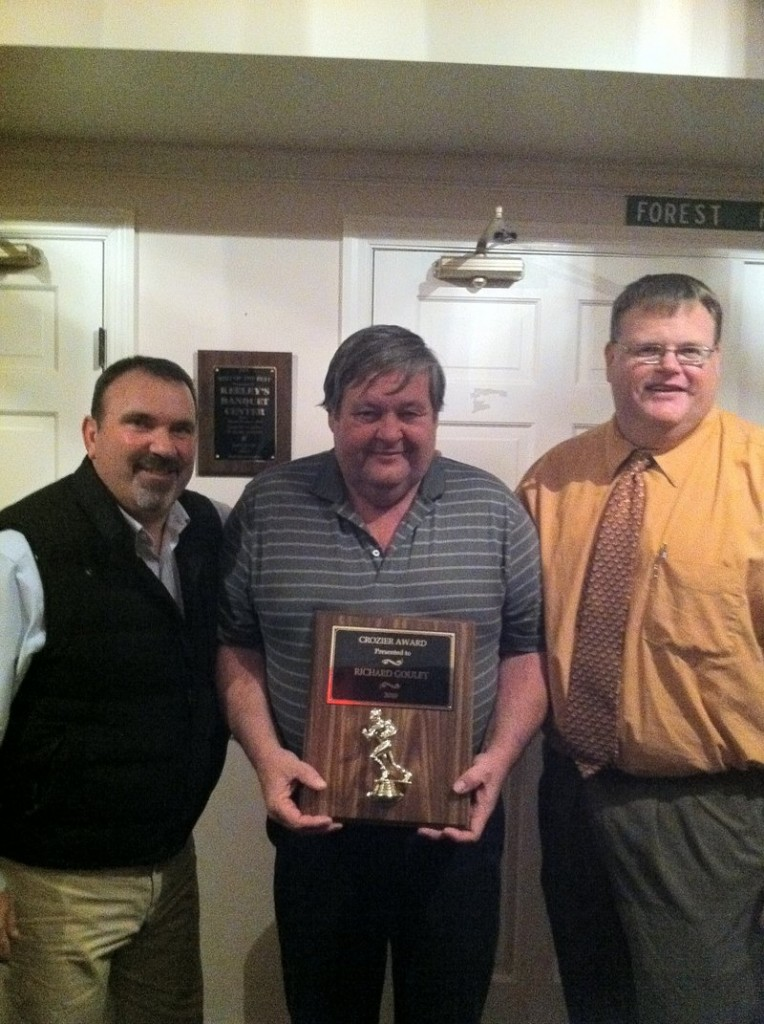 Richard Goulet, with fellow Marshwood High assistant football coach Guy Lajeunesse, left, and head coach John Caverly, was honored with the Crozier Award by the Southwestern Maine Board of Football Officials.