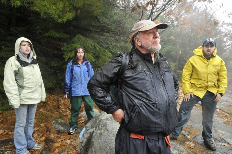 University of New England Professor Owen Grumbling and some of his students in a nature writing class stop at an overlook on Burnt Meadow Mountain in Brownfield.