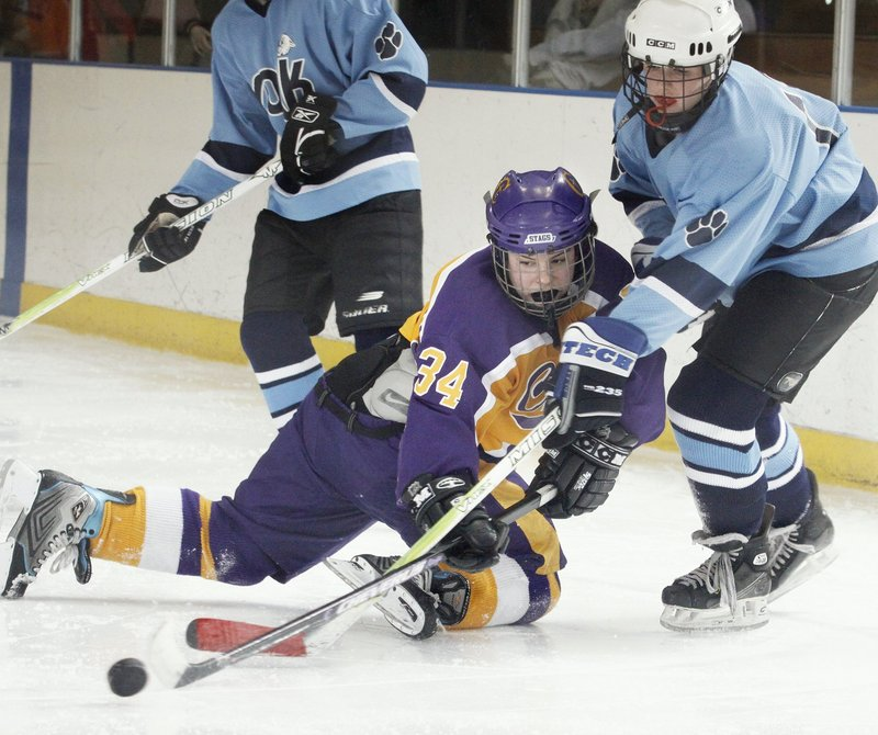 Katie Roy of Cheverus, center, battles with Julia Hird of York during a heated game last year. St. Dom's, Scarborough and Cheverus may be favorites, York expects to contend.