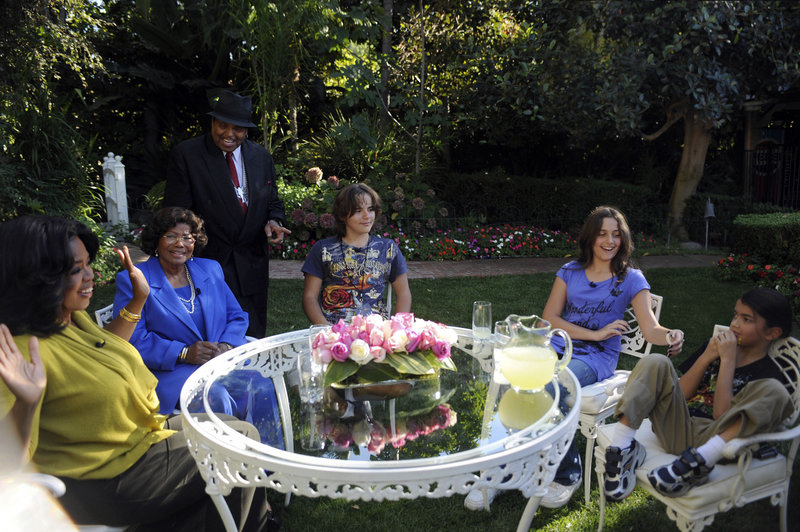 "Talk show host Oprah Winfrey, left, is seen with Katherine Jackson, second from left, mother of the late pop star Michael Jackson, in a taping of ""The Oprah Winfrey Show"" in Encino, Calif. Looking on are Joe Jackson, standing, and Michael's three children, from left, Prince, Paris and Blanket. The show aired Monday."