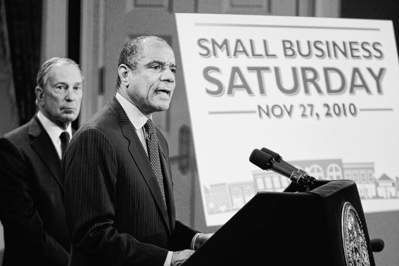Kenneth Chenault, CEO of American Express, right, speaks while New York City Mayor Michael Bloomberg listens during a news conference in New York to announce a program aimed at benefiting small businesses.
