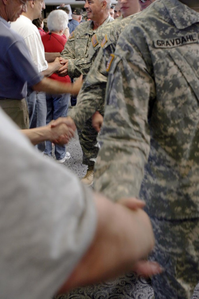 Maine residents greet returning service members in this 2007 file photo taken at Bangor Airport.