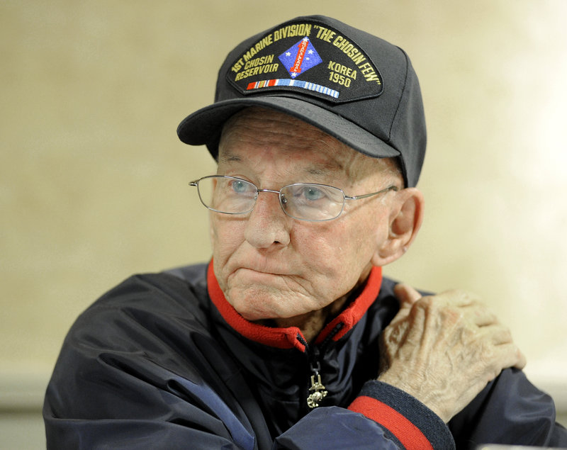 """Jim Hughes, 82, of Gorham recalls the frigid Battle of Chosin Reservoir in Korea. He still suffers from the pain of frostbite damage to his feet, hands and legs. """"The guys who didn't come home are the heroes. We're not heroes. We're just lucky to be here,"""" he said."""