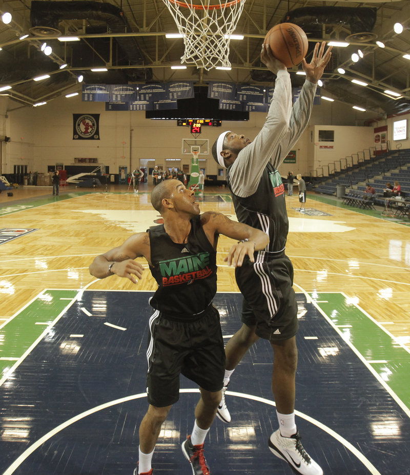 "Mario West puts a shot over James Lewis in practice. ""We love having Mario here. He was the ultimate player for us,"" said GM Jon Jennings."