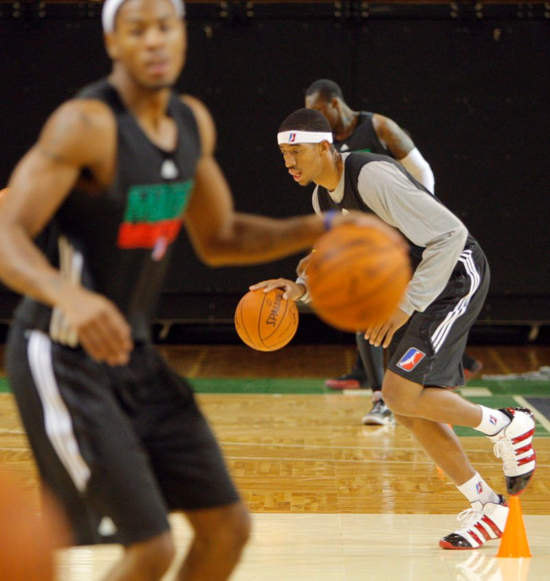 Magnum Rolle dribbles his way down the court during practice for the Red Claws, who will open their second D-League season Nov. 19 at the Portland Expo.