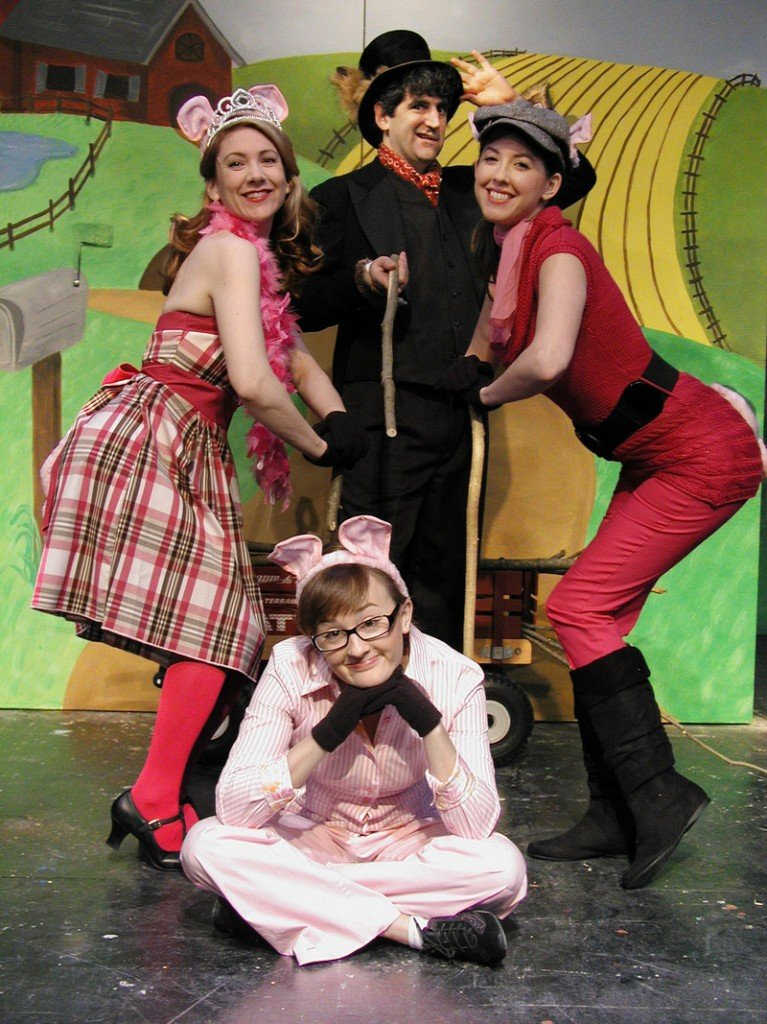 "Laura Durrell, seated, and, from left, Ellen Lindsay, Doug Shapiro and Alexandra Frankovich star in ""The Three Little Pigs."""