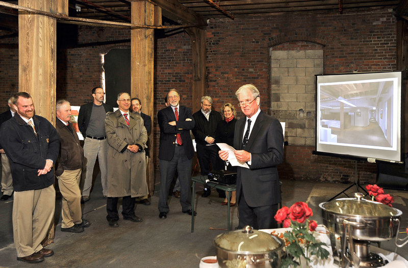 Coleman Burke of Waterfront Maine, owner of the Cumberland Cold Storage Building and developer of the Pierce Atwood project, speaks at a reception Wednesday.