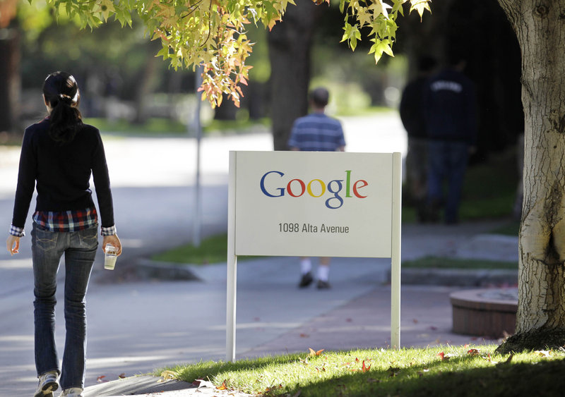 Employees walk around Google's campus in Mountain View, Calif., on Wednesday. The company is renowned for pampering its workers with free food and other perks.