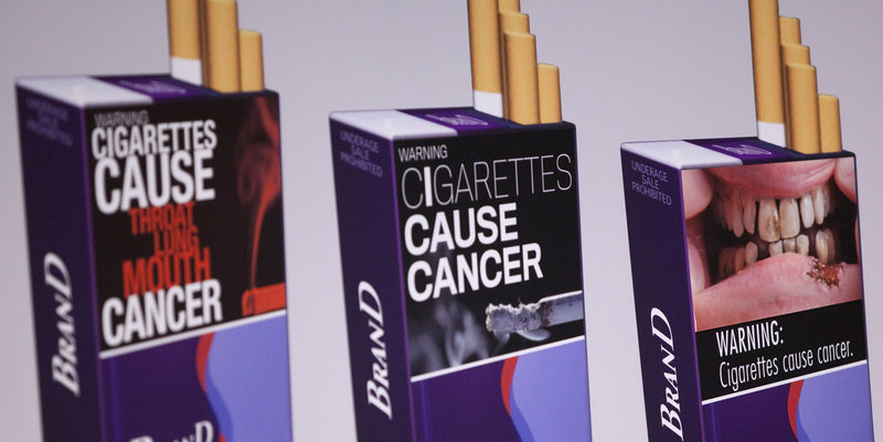 Illustrations of proposed warnings are shown on three sample cigarette packs. The more gruesome warnings could show emaciated cancer patients, diseased organs and corpses.