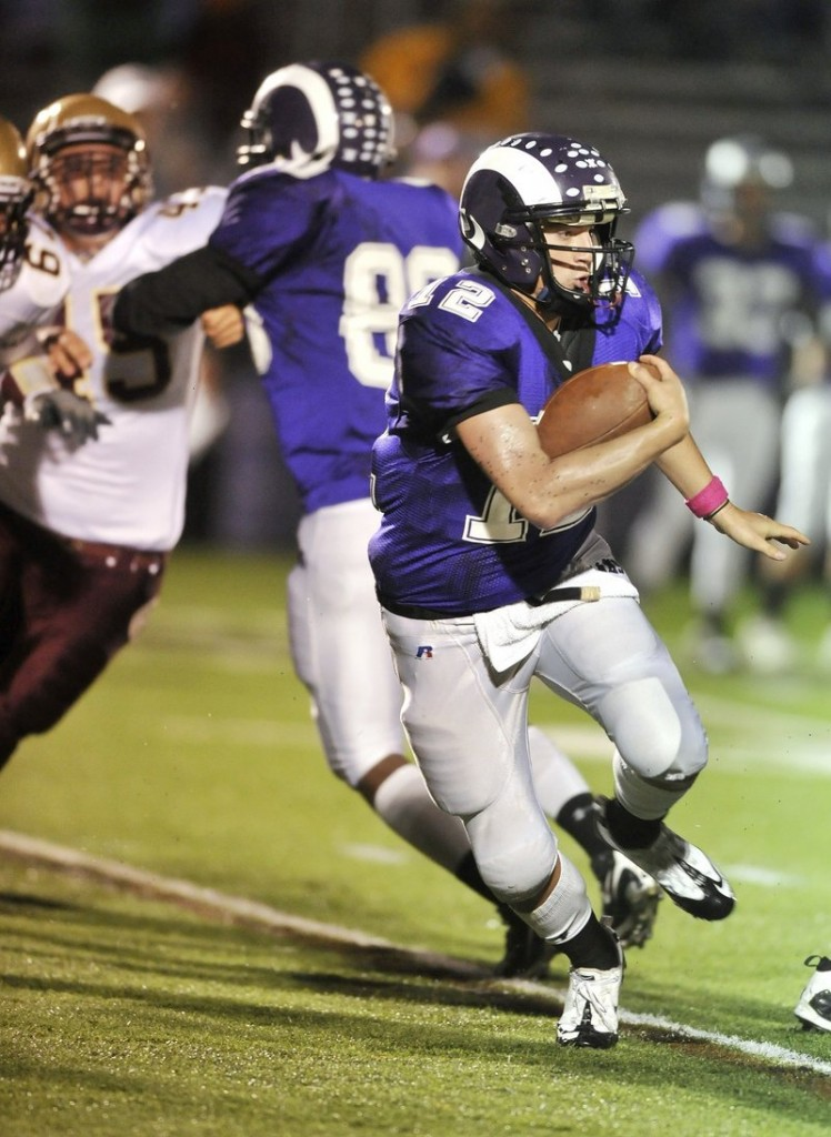 Jamie Ross of Deering leads a spread offense with his passing and running. Ross has thrown for 39 touchdowns and run for 26 in his three seasons as the Rams quarterback.