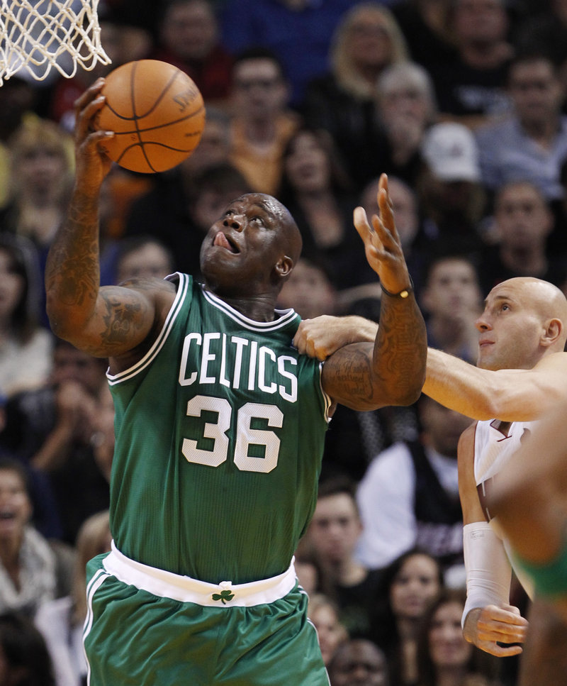 Shaquille O'Neal of the Boston Celtics gets inside position on Zydrunas Ilgauskas of the Miami Heat for a layup Thursday night during Boston's 112-107 victory.