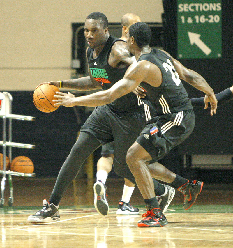 Keith 'Tiny' Gallon drives around a defender at Maine Red Claws practice Tuesday at the Portland Expo. The 19-year-old's guard-like athleticism could make him a versatile post player once he improves his inside game.