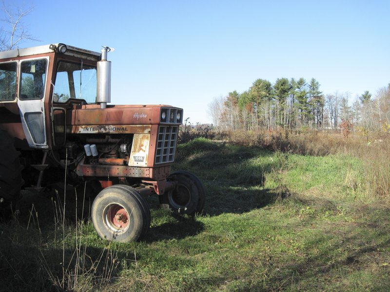 A derelict tractor stands idle on the southwest corner of a 100-acre plot of former farmland off Route 26, Friday. Construction of a 65,000-square-foot casino and resort may begin as early as next spring. Black Bear Entertainment, the developer, expects the first phase of the project to be completed by next year, with a grand opening planned for December 2011.