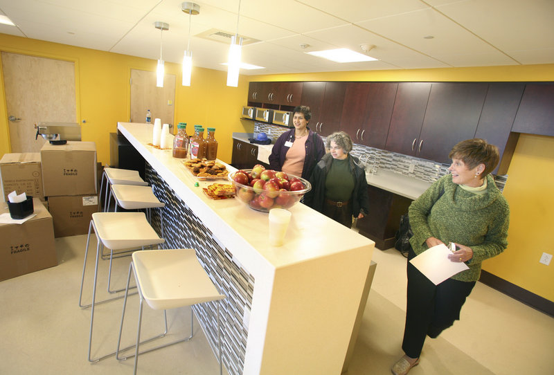 Suneela Nayak, Nan Solomons and Janet Smith look at the kitchen area of MaineHealth's new office space. The area has access to a rooftop deck that will be open next spring.