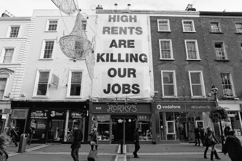 Irish troubles: A banner complaining about high shop rents is hung on a storefront Friday in central Dublin.
