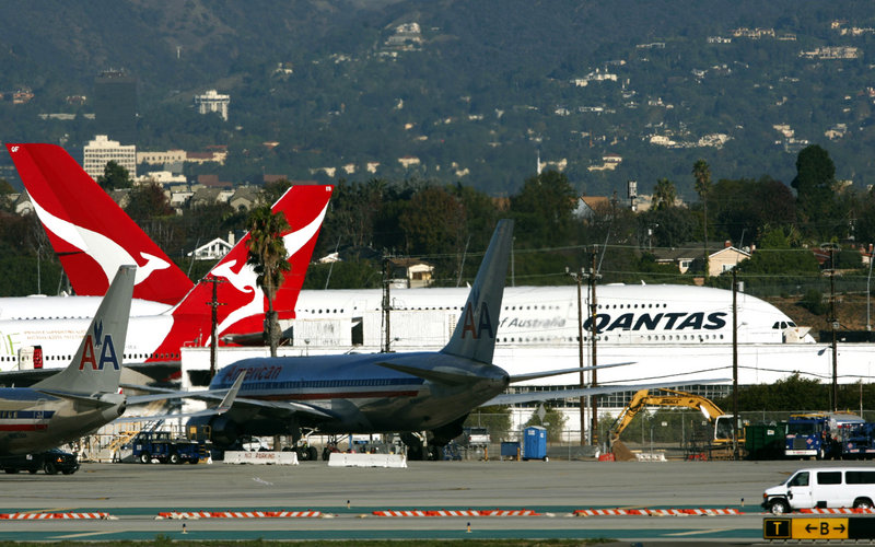 Two Qantas A380 superjumbo jets await inspection at Los Angeles International Airport on Friday. Last week leaking oil caused an engine to blow up over Indonesia.