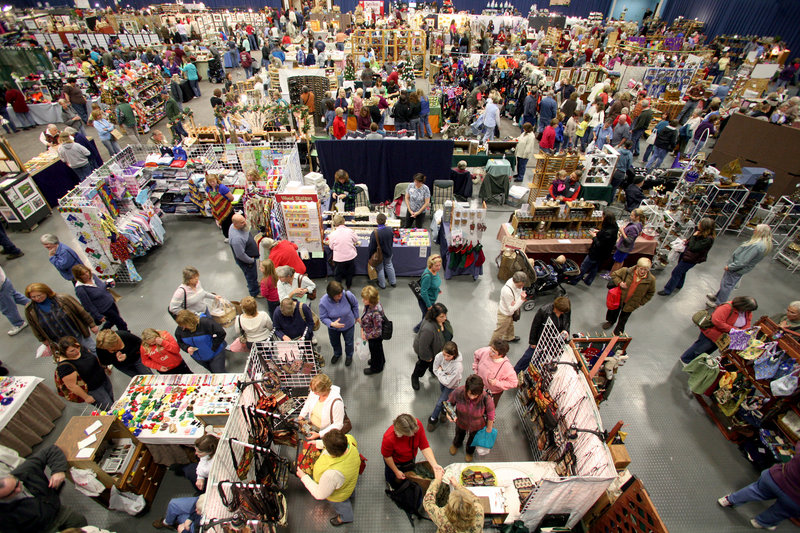 Shoppers make the rounds of booths at the Augusta Arts and Crafts Show. The show is hosted by the United Maine Craftsmen. The show's director, Aletha Boyle, says that