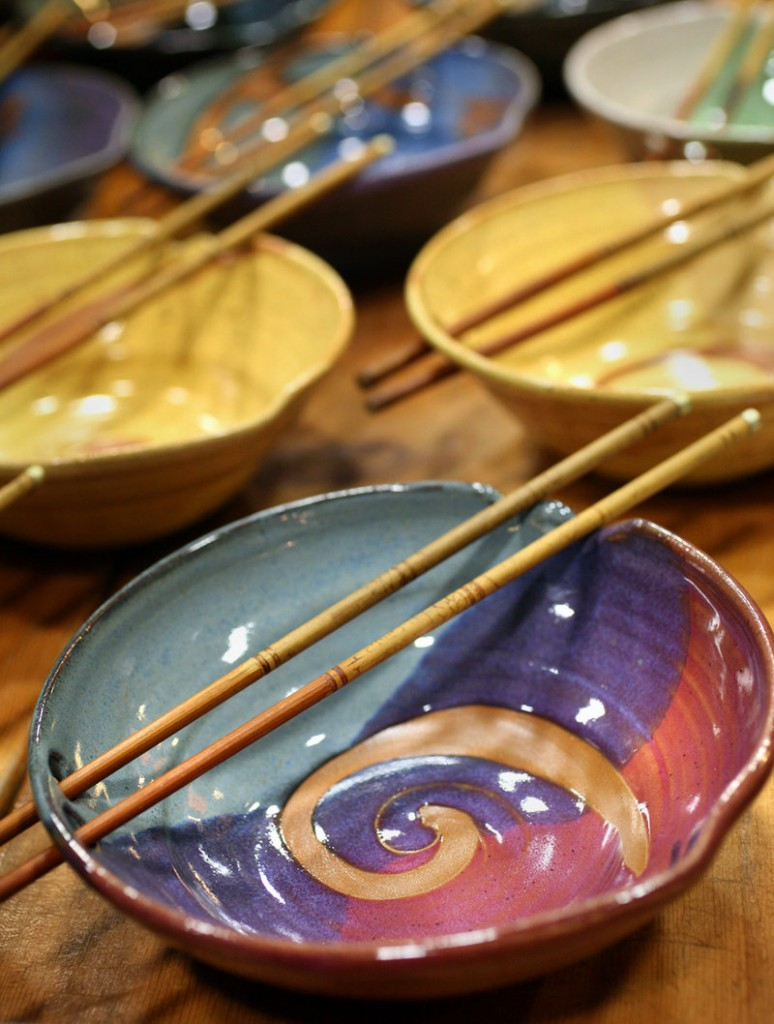 Stoneware clay rice bowls with chopsticks created by artist Keith Herklotz of Down to Earth Pottery in Blue Hill are part of the color of Saturday's show.