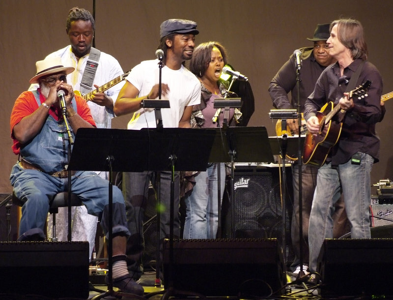 Musicians from Playing For Change and Jackson Browne, right, perform at the Theatre Within's 30th annual John Lennon Tribute Concert at the Beacon Theatre in New York.