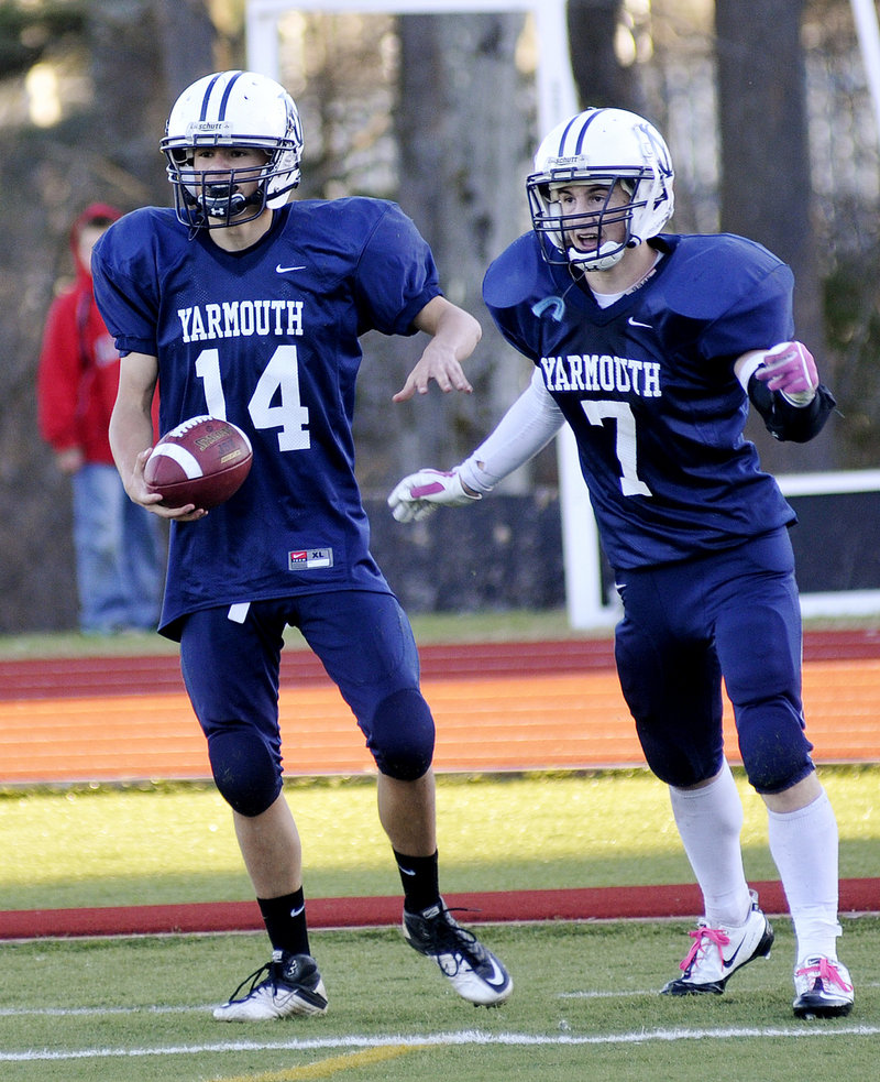 Brady Neujahr, left, and Tommy O'Toole celebrate in the end zone after Neujahr's 65-yard run that stood up as the winning touchdown for the Clippers.