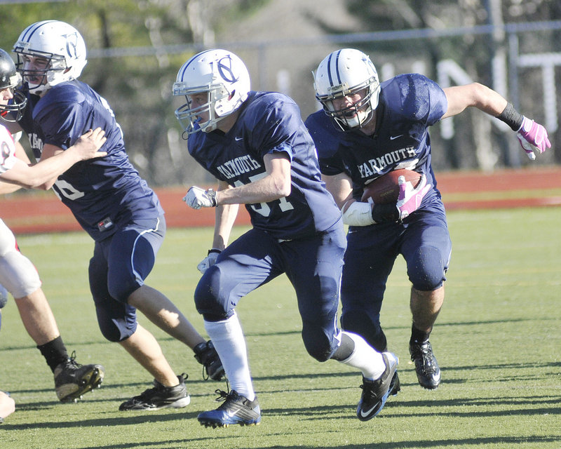 Nick Proscia, who gained 94 yards on 18 carries for Yarmouth, finds room while following his teammate, Asa Arden. The Clippers will take an 11-0 record into the state final.