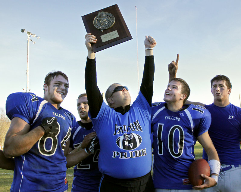Assistant coach Jeff Garneau celebrates with Mountain Valley captains John Durland, left; Cam Kaubris, 10; and Joshua Allen, right. Garneau's son died of leukemia in April. He would have turned 18 on Saturday.