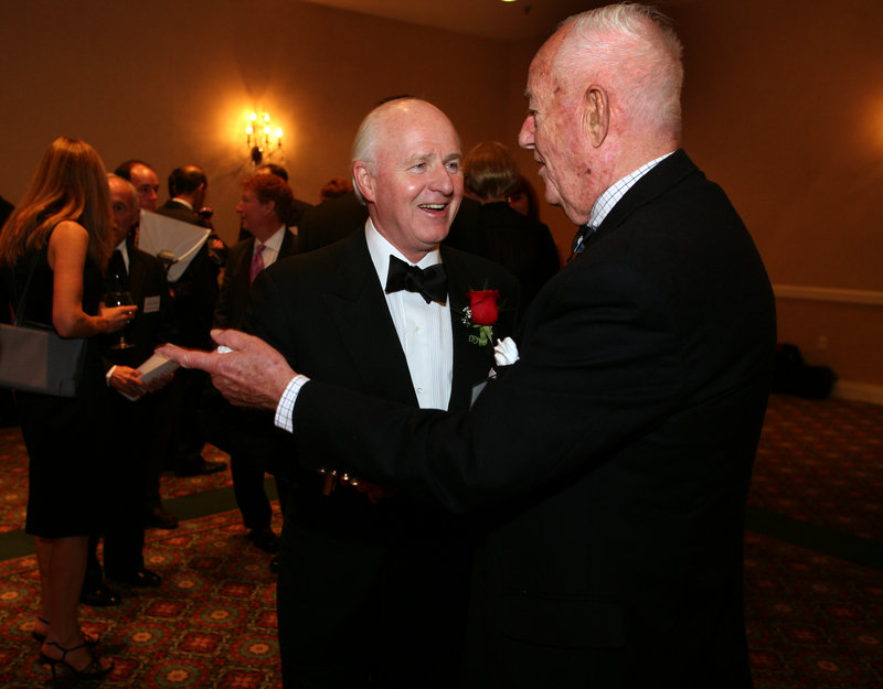 Spurwink Humanitarian of the Year Award winner Richard L. Connor, left, chief executive officer of MaineToday Media, visits with Phineas Sprague during Saturday's reception at the Portland Marriott at Sable Oaks in South Portland.