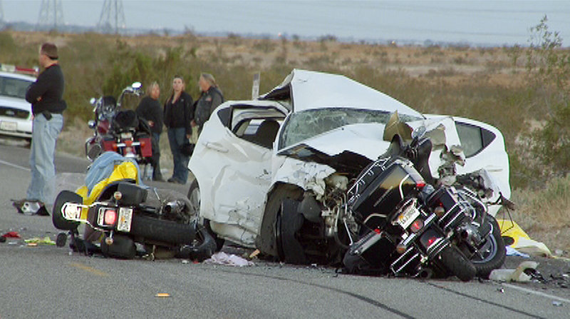 Rescuers and victims are seen at the site of a collision involving a car and several motorcycles on a remote desert highway near Ocotillo, Calif., in this photo taken from video made Saturday. The car's driver was arrested on suspicion of driving under the influence.